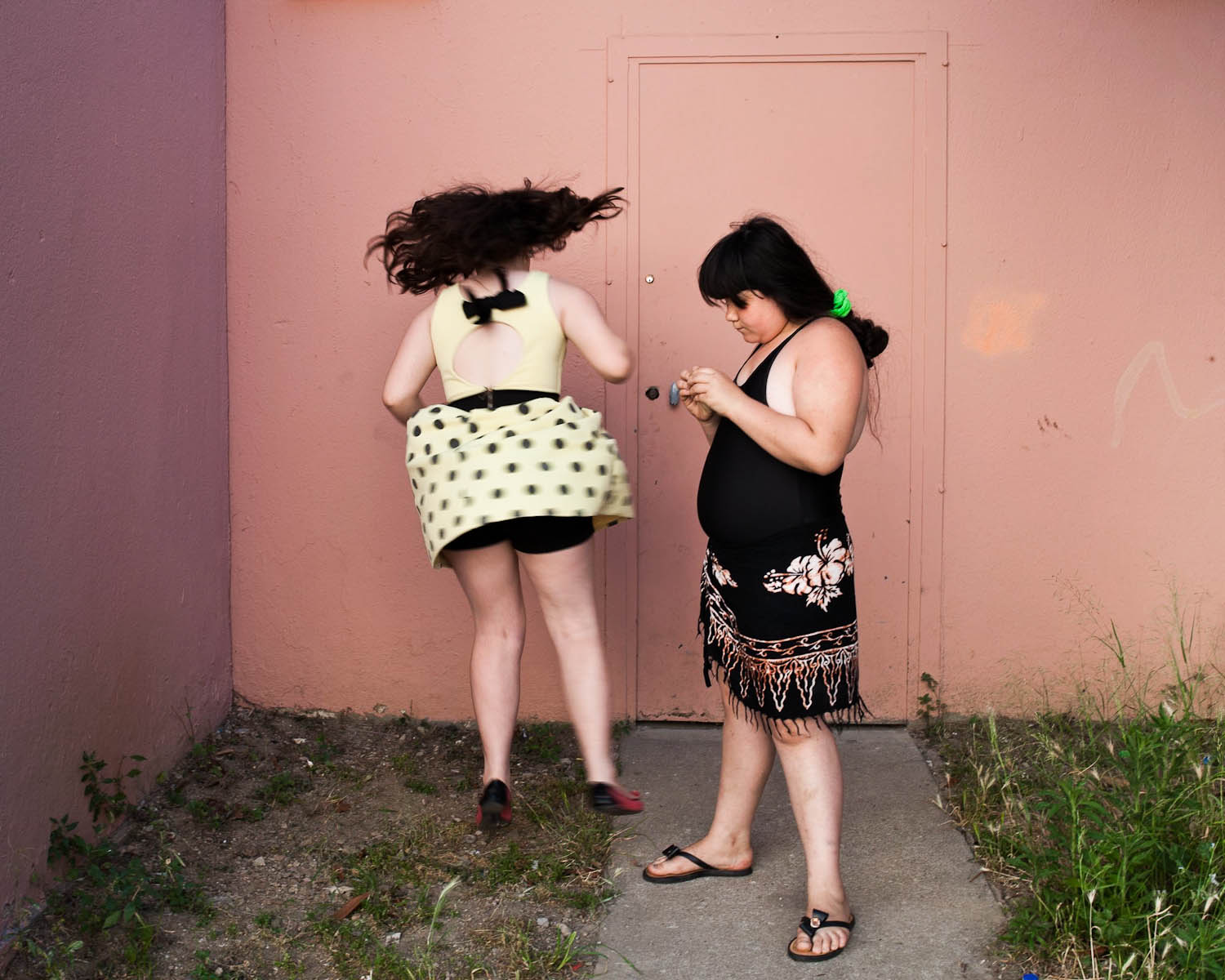 Ilona and Maddelena playing in the street of their neighbourhood